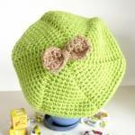 Crochet kids tam hat in green and o..